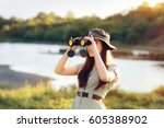 explorer girl with camouflage... | Shutterstock . vector #605388902