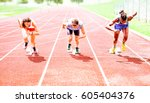 row of multiracial runners at... | Shutterstock . vector #605404376