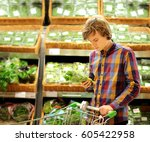 young man buying vegetables at... | Shutterstock . vector #605422958