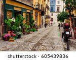 old street with flowers in... | Shutterstock . vector #605439836