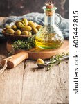 olive oil and bowl of olives on ...   Shutterstock . vector #605442815