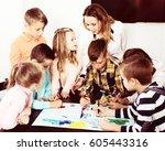 portrait cheerful team of... | Shutterstock . vector #605443316