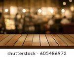 wood table top on blur bokeh... | Shutterstock . vector #605486972