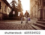happy couple shopping together... | Shutterstock . vector #605534522