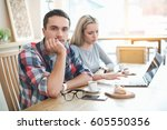 day in cafe. young couple in... | Shutterstock . vector #605550356