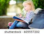 adorable little schoolgirl... | Shutterstock . vector #605557202