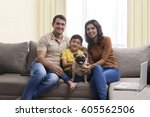 smiling family with son and pug ...   Shutterstock . vector #605562506