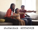 excited family pointing at... | Shutterstock . vector #605565428