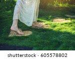 Girl Walking Barefoot On The...