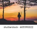 silhouette of child on the... | Shutterstock . vector #605590322