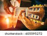 men playing acoustic guitar... | Shutterstock . vector #605595272