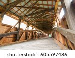 historic wooden covered bridge... | Shutterstock . vector #605597486