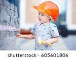 portrait of cute little builder ...   Shutterstock . vector #605601806