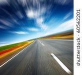 blurred asphalt road and blue... | Shutterstock . vector #60562201