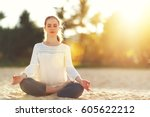 woman practices yoga and... | Shutterstock . vector #605622212