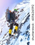 climber reaches the summit of... | Shutterstock . vector #605626592