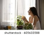 young woman drinking juice at... | Shutterstock . vector #605633588