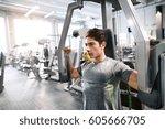 hispanic man in gym sitting on... | Shutterstock . vector #605666705