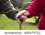 senior couple hands on the cane | Shutterstock . vector #605673722