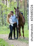 happy couple with a horse in a... | Shutterstock . vector #605680226