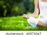 in the lotus posture close up | Shutterstock . vector #60573367