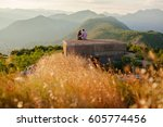 couple travel mountains and sea ... | Shutterstock . vector #605774456