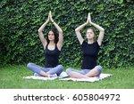 two women doing yoga | Shutterstock . vector #605804972