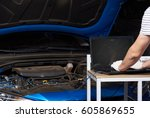 changing car engine setting.... | Shutterstock . vector #605869655