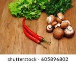 vegetables on a wooden... | Shutterstock . vector #605896802