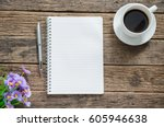 notebook coffee cup and pen... | Shutterstock . vector #605946638