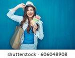 smiling woman traveler holding... | Shutterstock . vector #606048908
