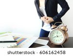alarm clock and documents on... | Shutterstock . vector #606162458