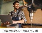 shot of a smiling carpenter... | Shutterstock . vector #606171248