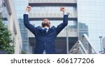 a businessman dancing in the... | Shutterstock . vector #606177206