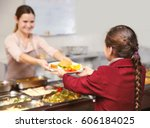 pleasant woman giving lunch to... | Shutterstock . vector #606184025