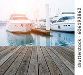 wood platform beside yachts at... | Shutterstock . vector #606193862