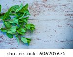 fresh mint on wooden background ... | Shutterstock . vector #606209675