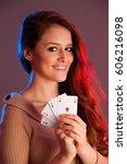 beautiful brunette holding four ... | Shutterstock . vector #606216098