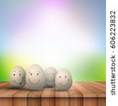 cute easter eggs on a  wooden... | Shutterstock .eps vector #606223832