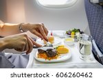 tray of food on the plane  | Shutterstock . vector #606260462