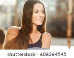 beautiful girl in dark shirt | Shutterstock . vector #606264545