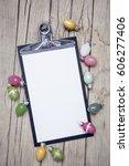 eastereggs on wood background...   Shutterstock . vector #606277406