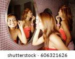 two women in public restroom ...   Shutterstock . vector #606321626