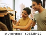 couple in clothing store ... | Shutterstock . vector #606328412