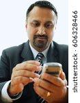 Small photo of Businessman using PDA phone
