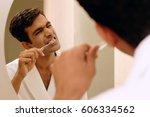 man brushing his teeth | Shutterstock . vector #606334562