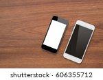 smartphone on wooden table | Shutterstock . vector #606355712