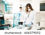 good looking chemists looking... | Shutterstock . vector #606379052