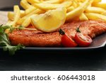 dish of wiener schnitzel and... | Shutterstock . vector #606443018