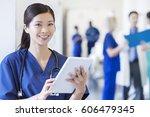 smiling portrait ethnic female... | Shutterstock . vector #606479345